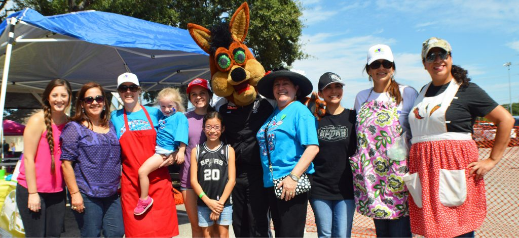 volunteers with coyote at festival