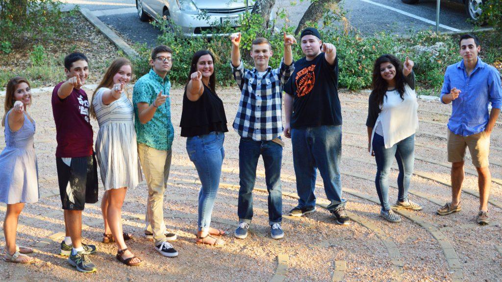seniors pointing at camera_16-9 ratio