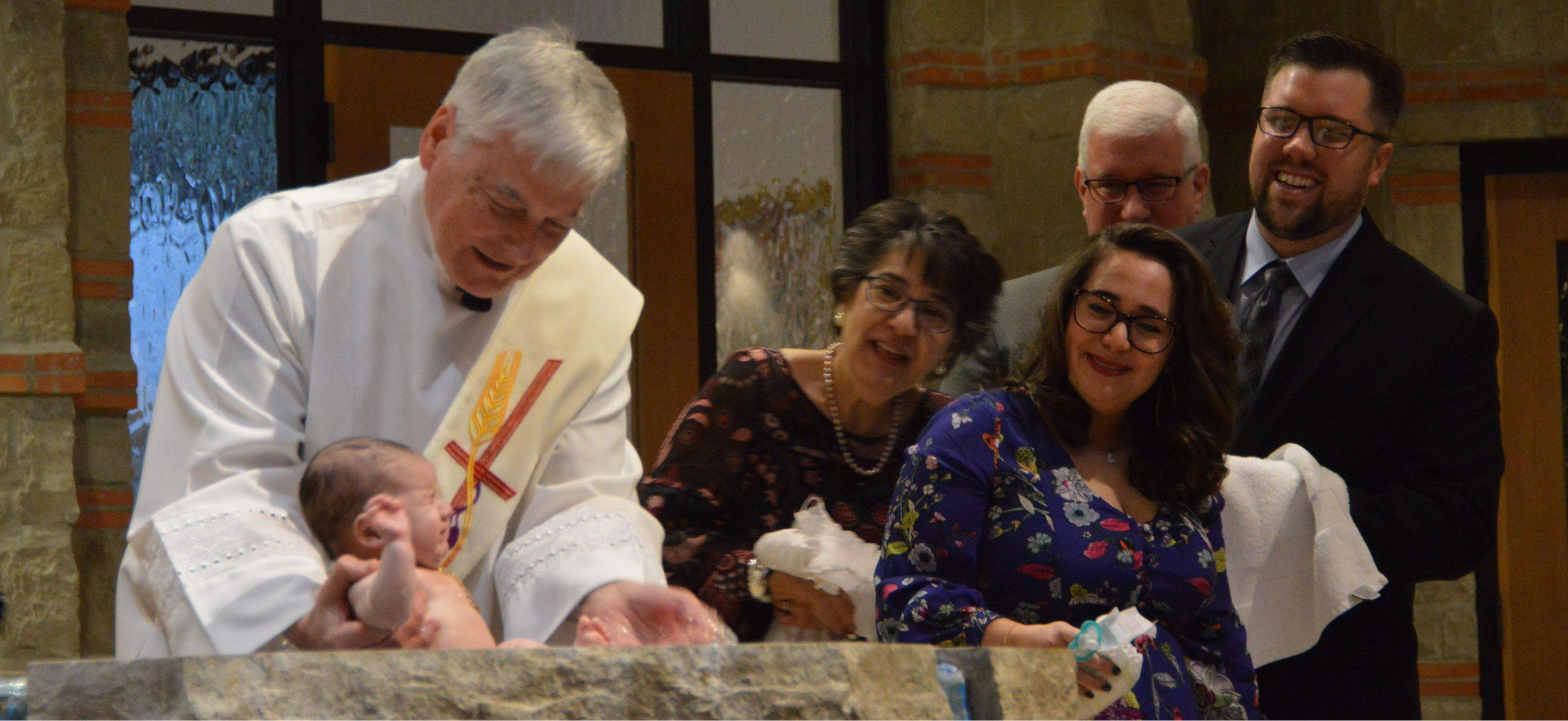 Deacon Jim Baptism with parents and godparents