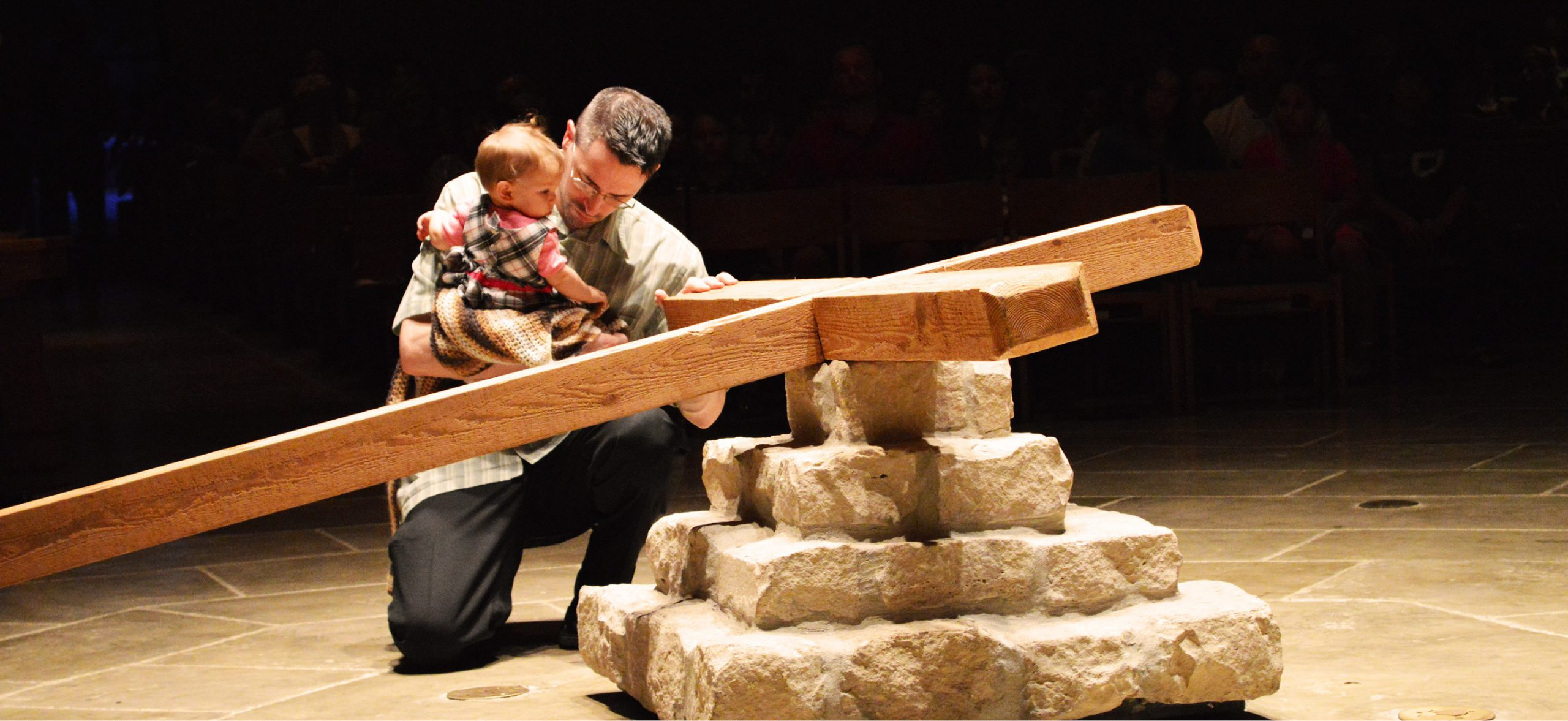 Dad-Venerating-Cross-with-Child-scaled